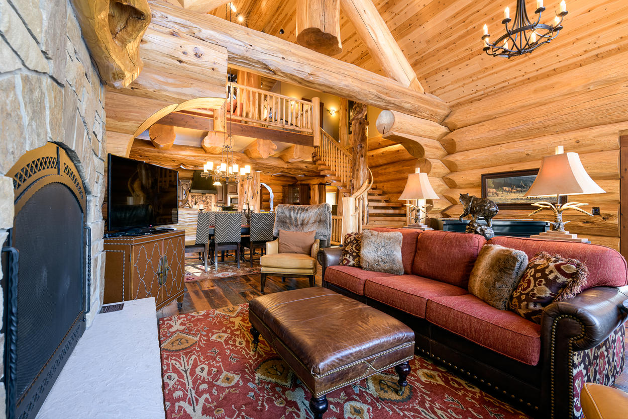 Vaulted ceilings compliment the great room, along with a TV and cozy fireplace.