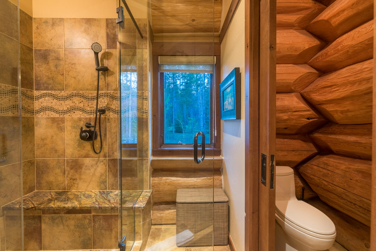 The shower in the Master ensuite is sumptuous and spacious, and include a granite bench below the showerhead.