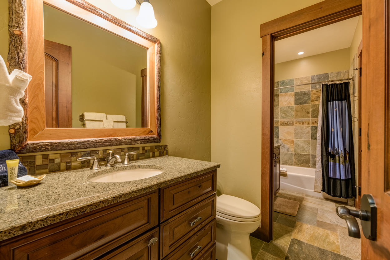 The fourth guest bedroom has its own ensuite bathroom with a single sink and shower/tub combination.