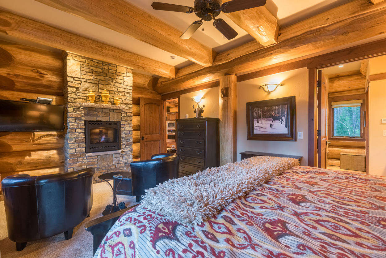 The Master Bedroom also has its own fireplace and sitting area, a TV, and an attached ensuite bathroom.
