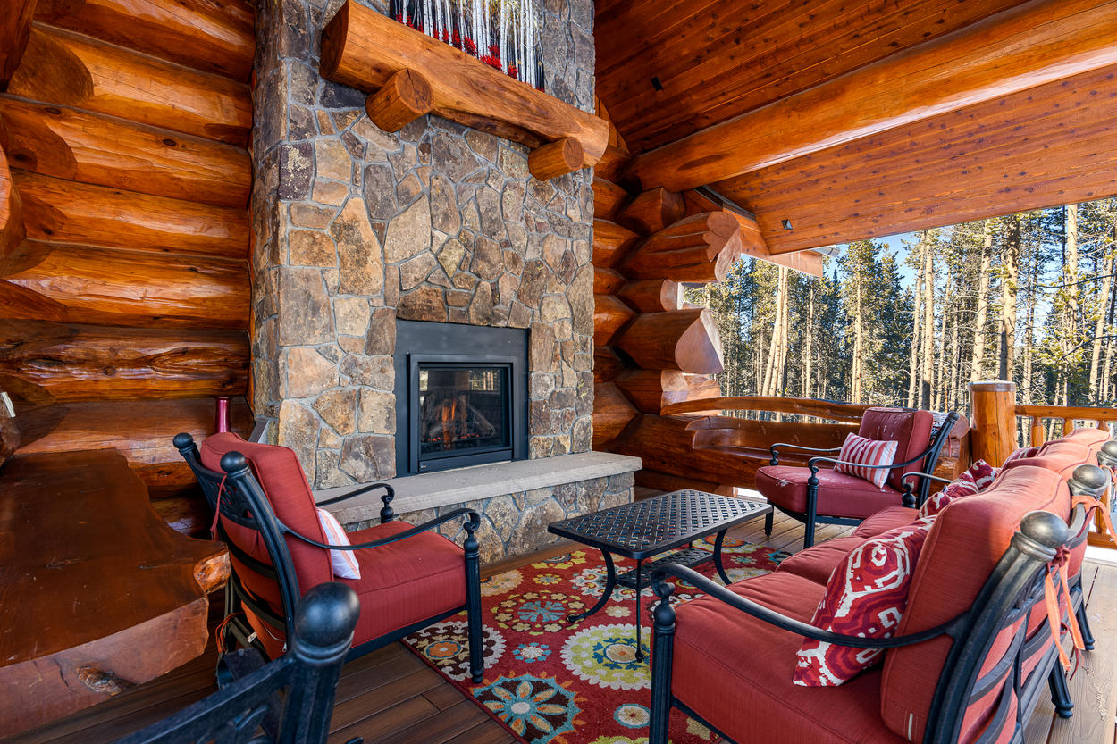 Take a seat and relax in the covered outdoor living area on the deck