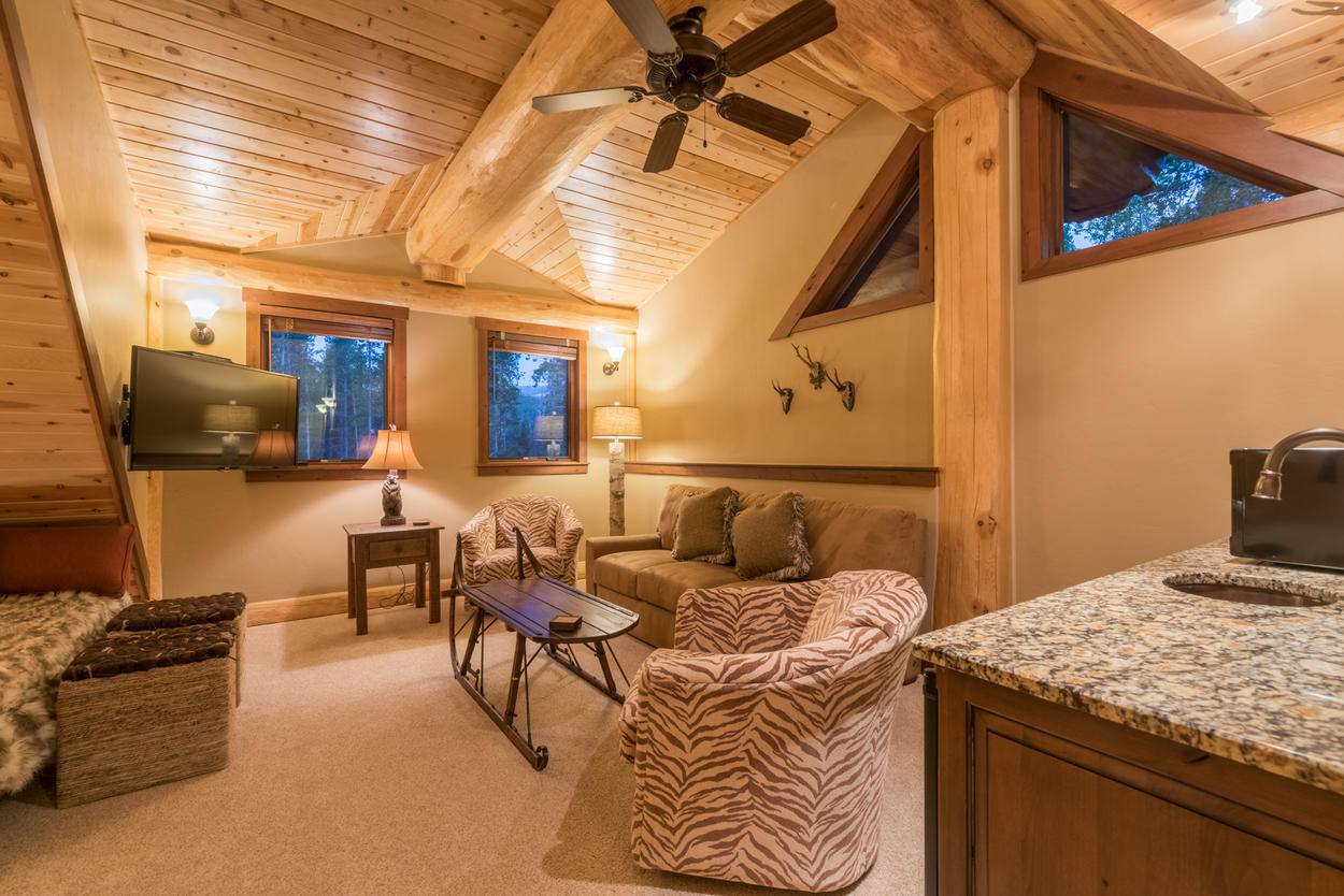 The loft is decorated in an eclectic style, which adds a unique flavor to the traditional cabin design.
