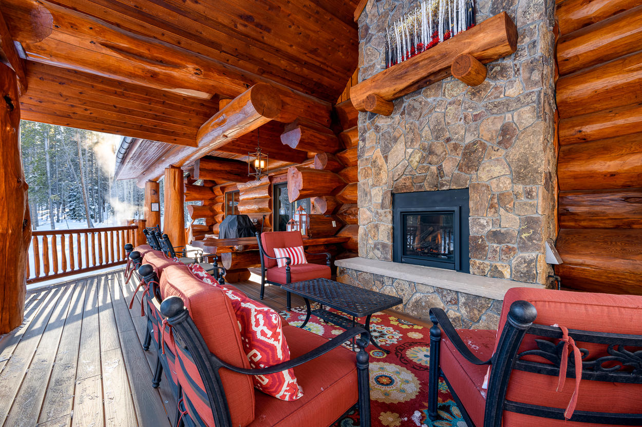 Bring the fun outdoors with the covered living area on the deck, complete with fireplace and plenty of seating