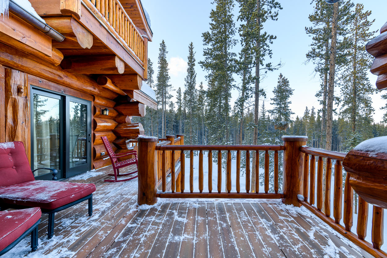 Towering pines and a tranquil forest surround the deck area