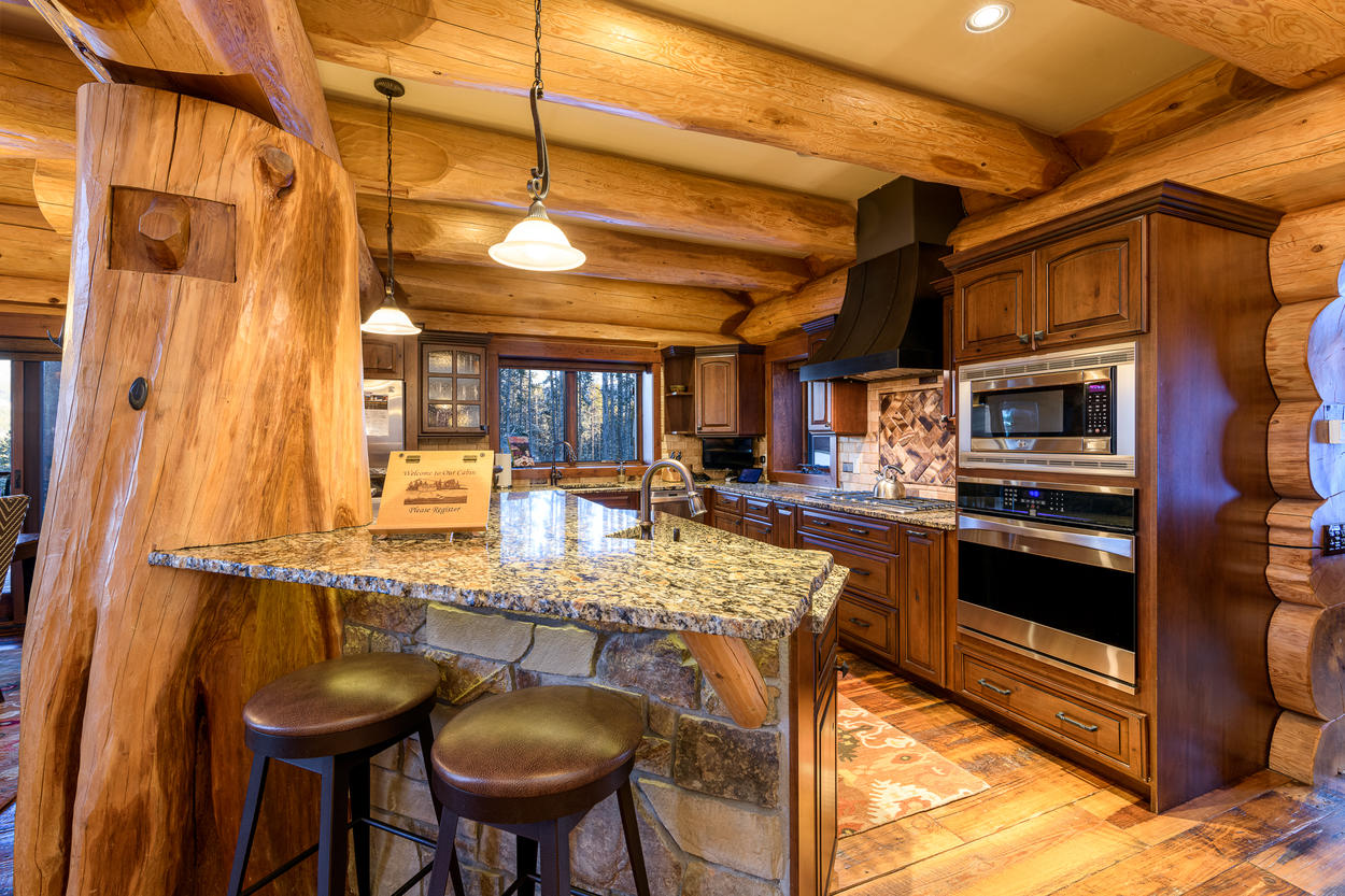 Granite countertops provide plenty of space to prepare and cook meals for the whole family.