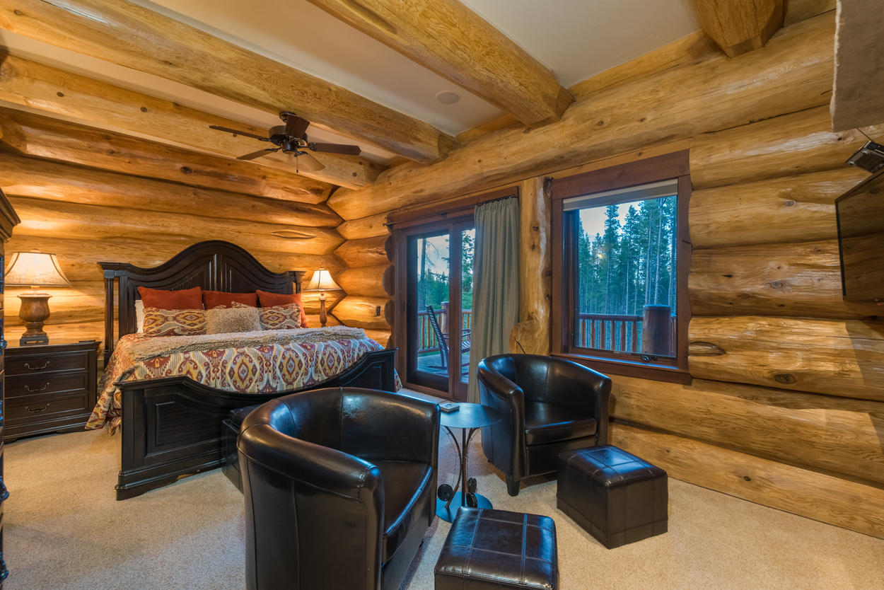 The Master Bedroom on the main level has a king-size bed and access to a large balcony.