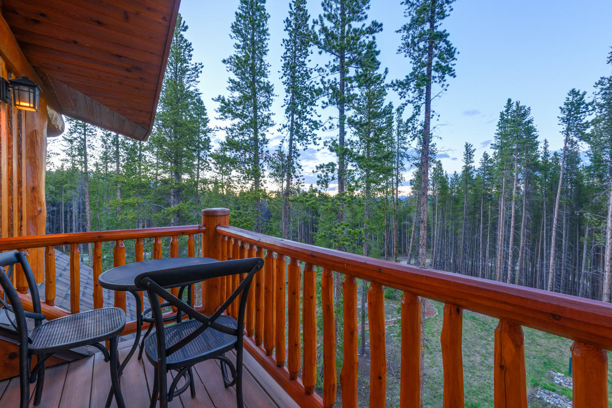 The private balcony looks over the trees of the Breckenridge hillside.