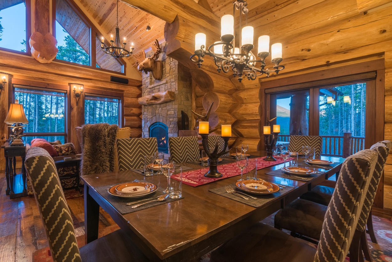 The large wooden dining table can accommodate up to eight guests.