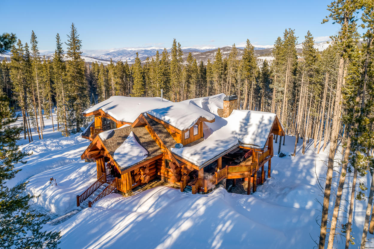 Perched on a subtle hill in the middle of a clearing of pines, the first thing you'll notice is the traditional log cabin architecture