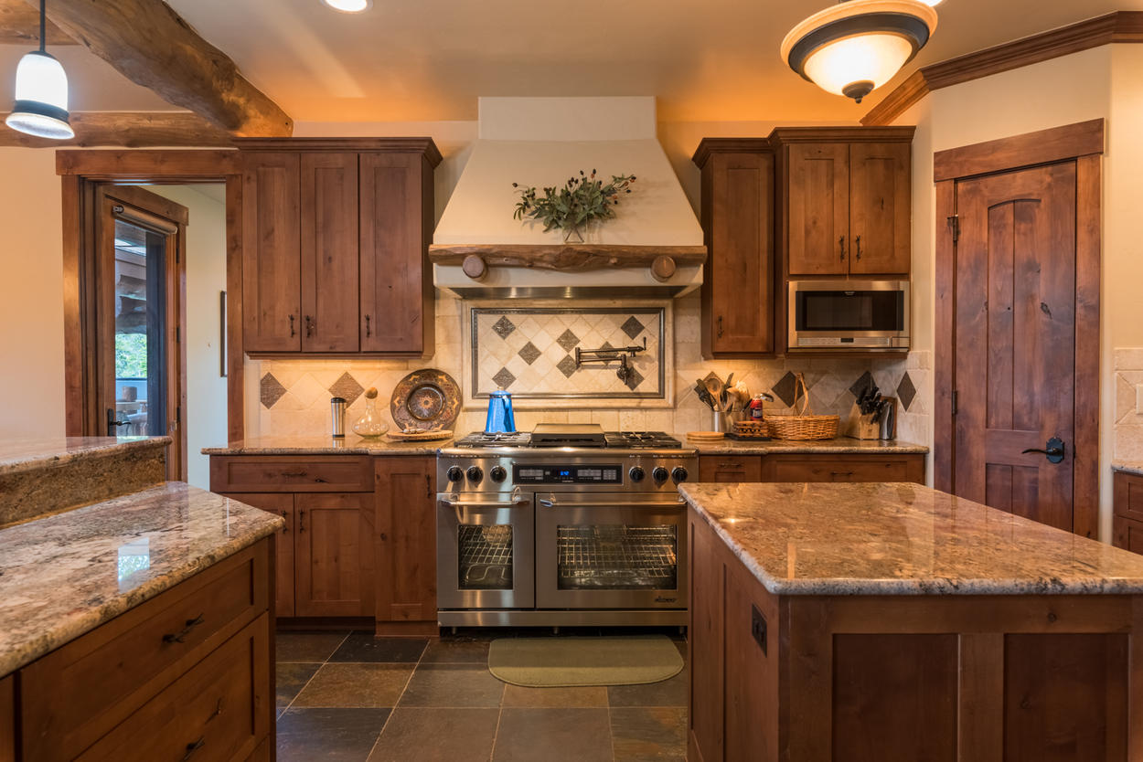 The gourmet kitchen features custom cabinetry and stainless steel appliances.