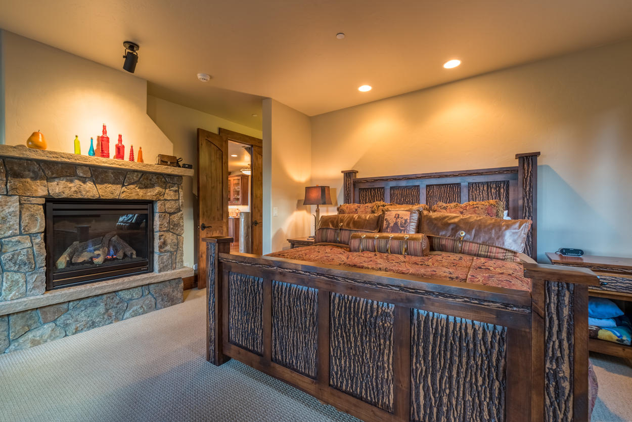 The Master Bedroom is on the main level, and has a king-size bed and a cozy gas fireplace.