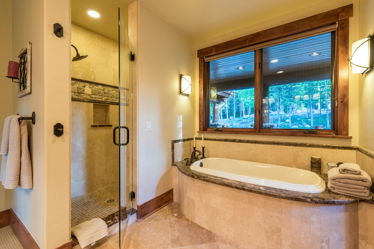 After a long day on the mountain, unwind with a soak in the Master Bathroom's tub or enjoy the rainfall showerhead in the walk-in shower.