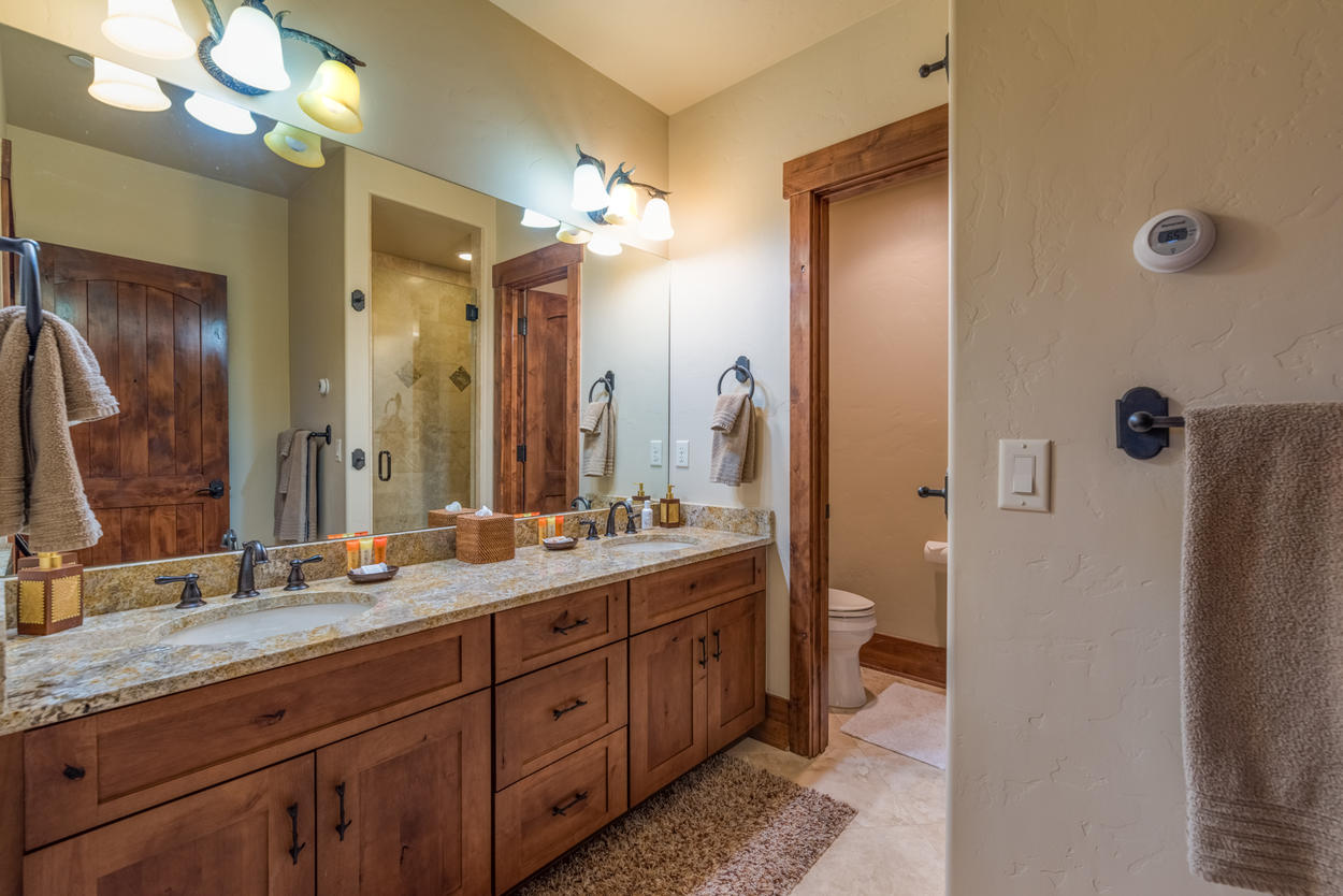 In the ensuite, there are two sinks and a walk-in shower.