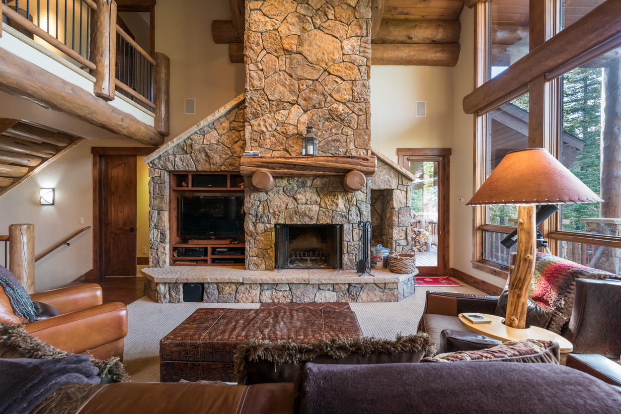 The great room also centers around a two-story wood-burning fireplace.