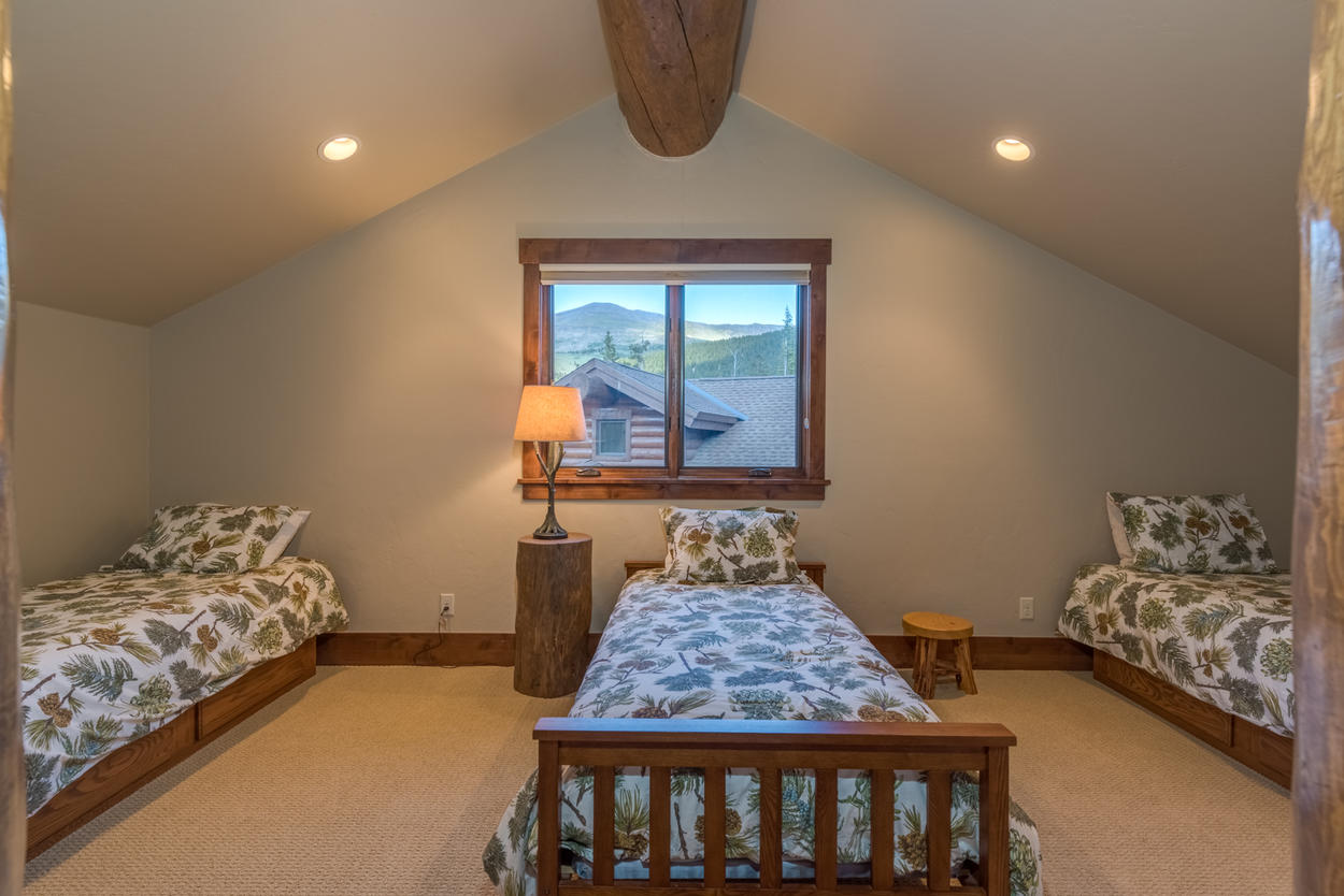 The sleeping area within this guest bedroom is perfect for keeping a close eye on the youngsters as they dream about tomorrow's adventures.