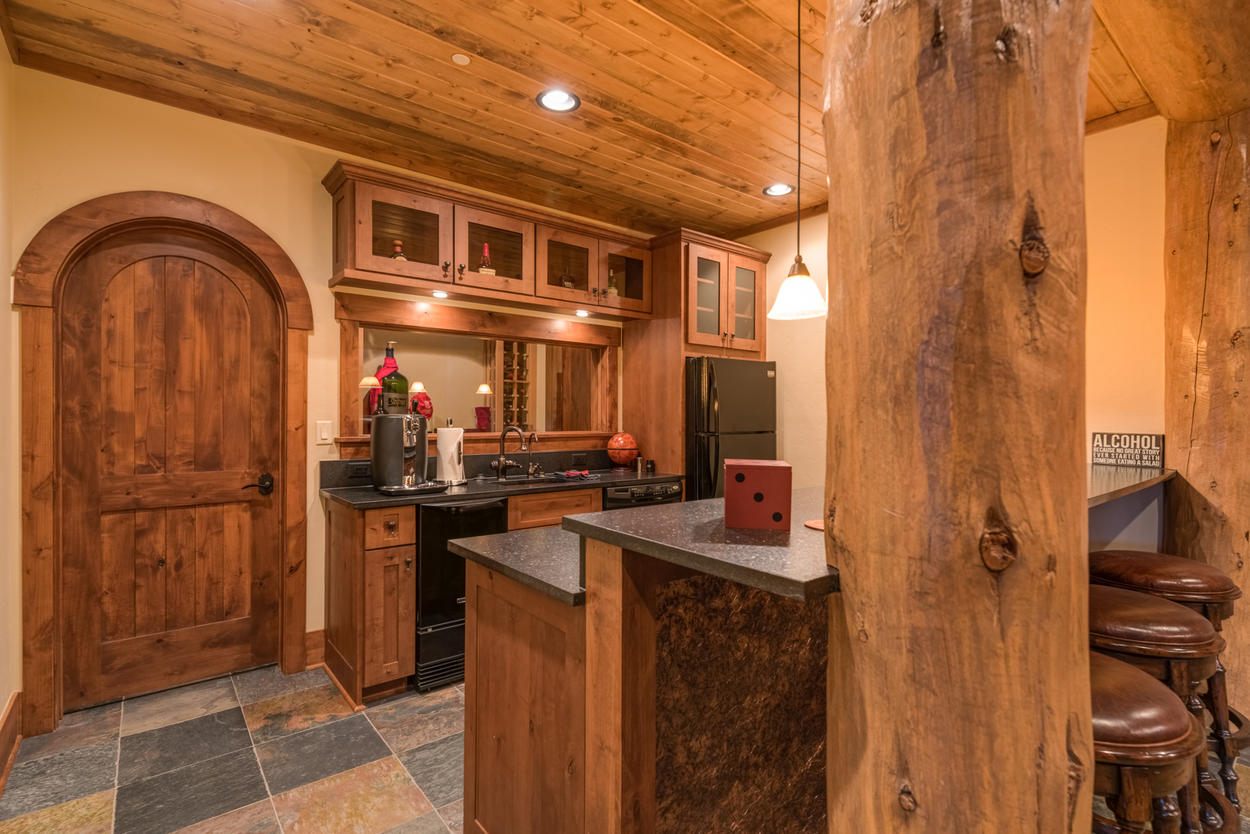 The lower level kitchenette has everything you need to keep your guests entertained all night.
