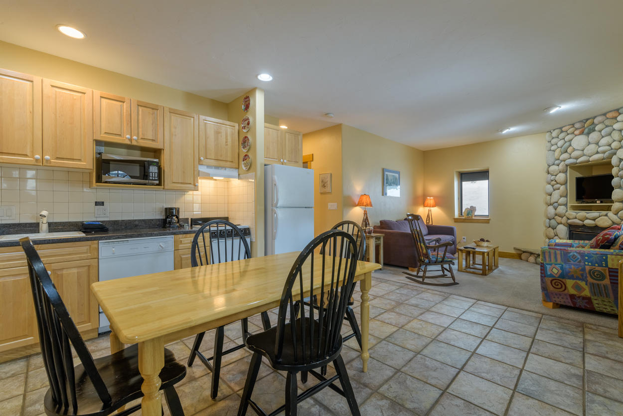 There's a second kitchen on the lower level, which opens up to a cozy den.