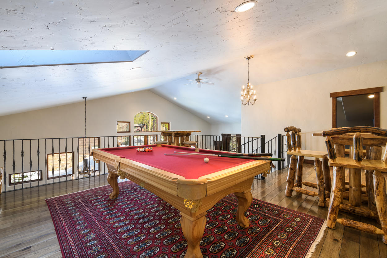 Upstairs in the loft that overlooks the main living area, there's a pool table and sitting area.