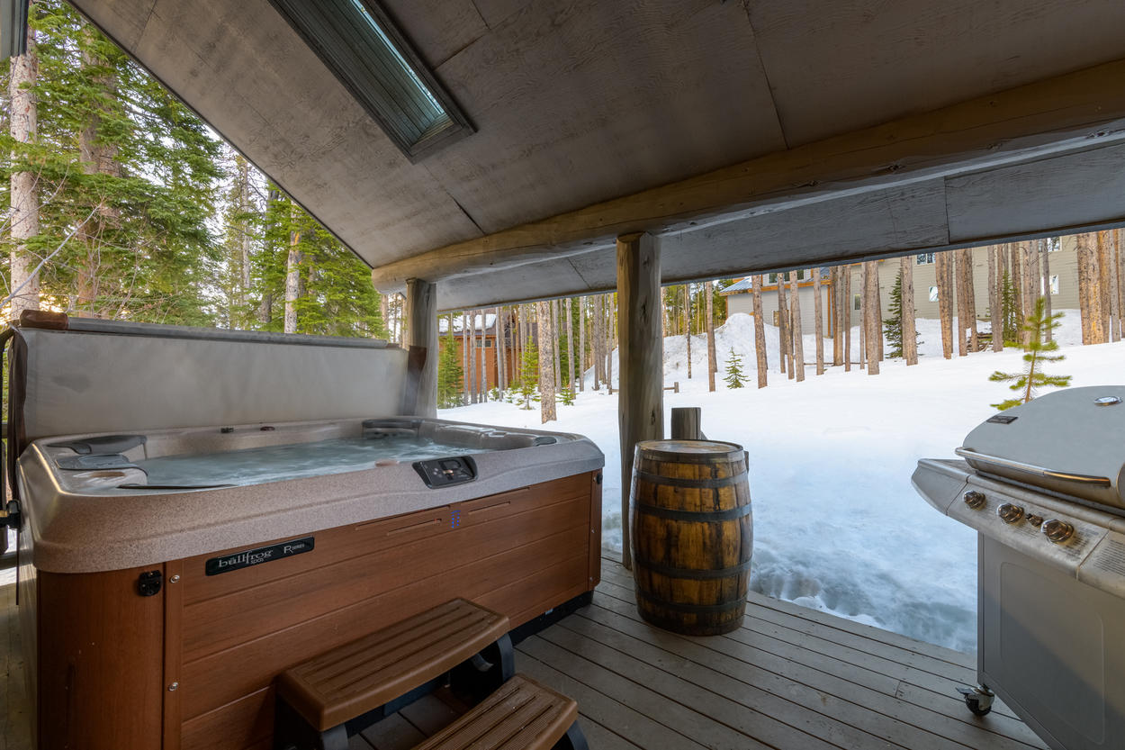 The private hot tub and gas grill are located on the covered deck, which you can access through the living area or Master Suite.