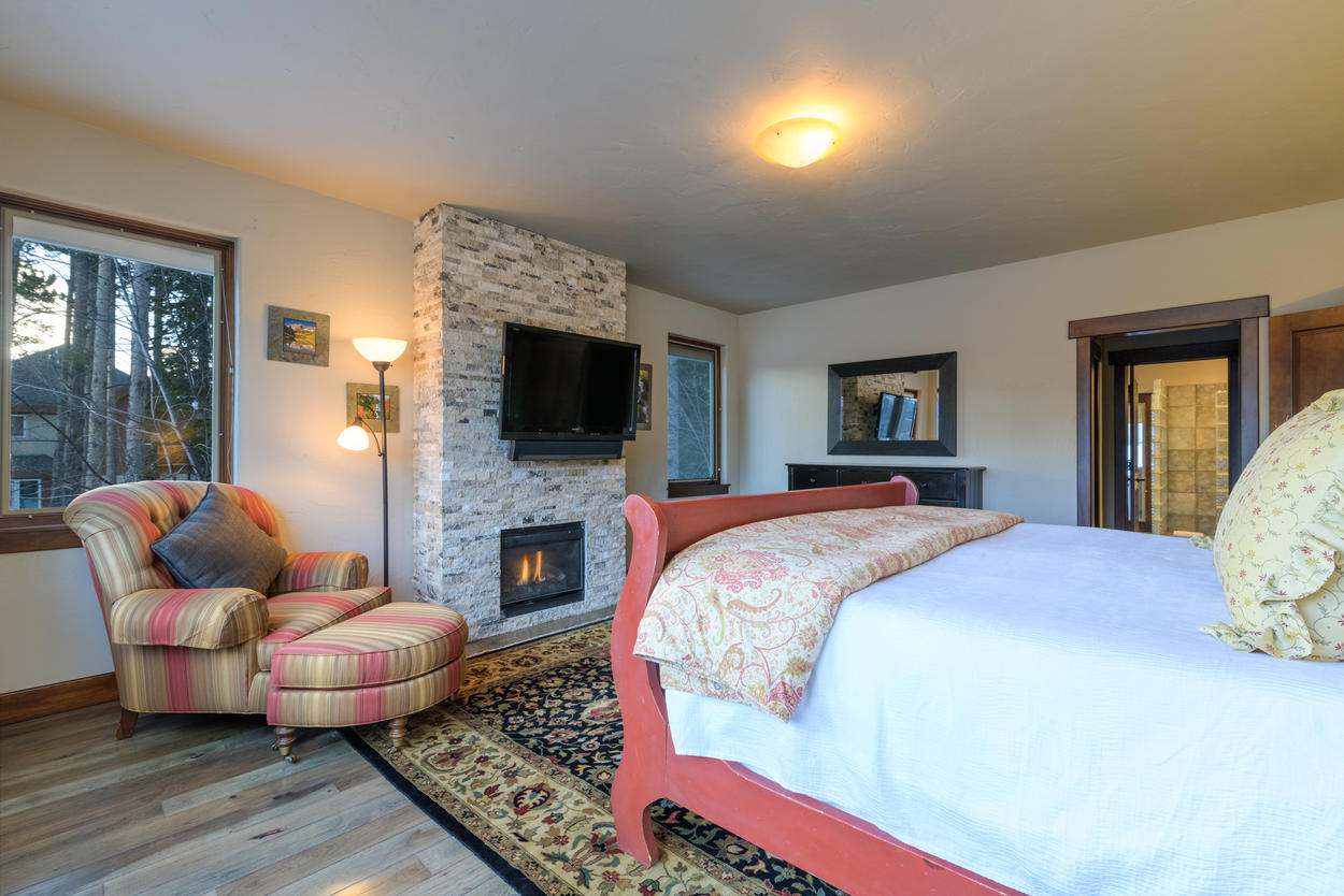 The Master Suite has its own attached ensuite bathroom, located through the doors on the right.