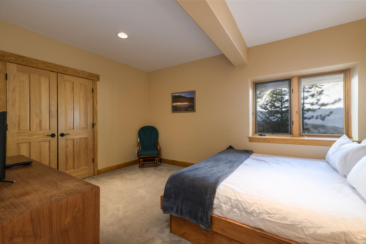 The lower level guest bedroom has brilliant views of the surrounding mountains and valley.