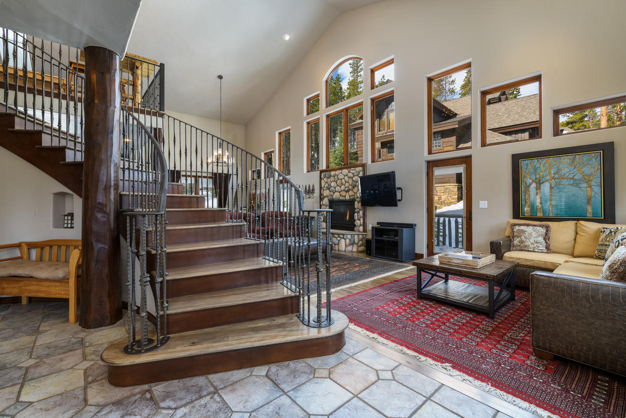 The Great Room has a grand stairwell in the entryway, and opens up to ample living space.