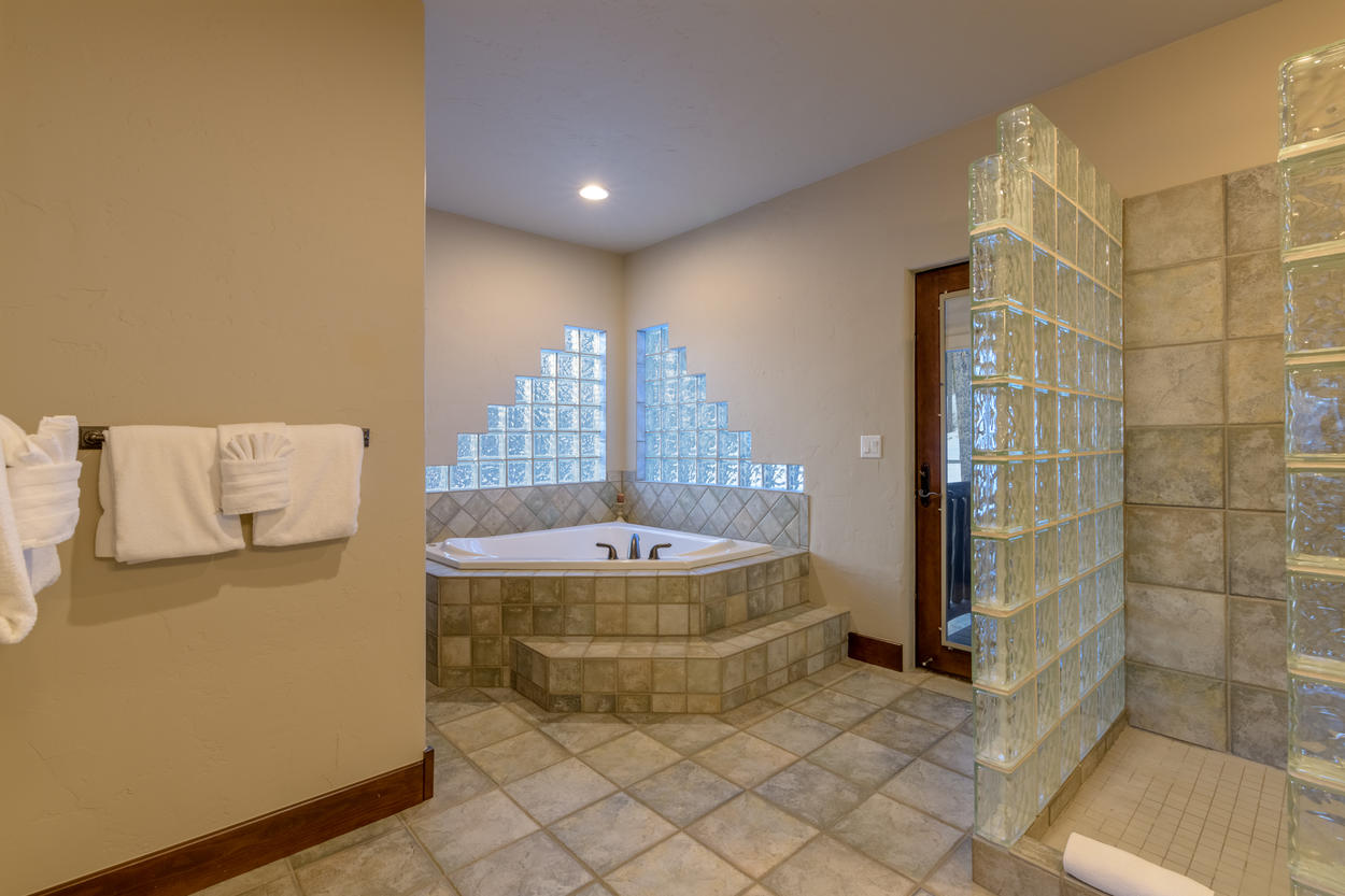 A large jetted tub is located in the corner of the Master Ensuite.
