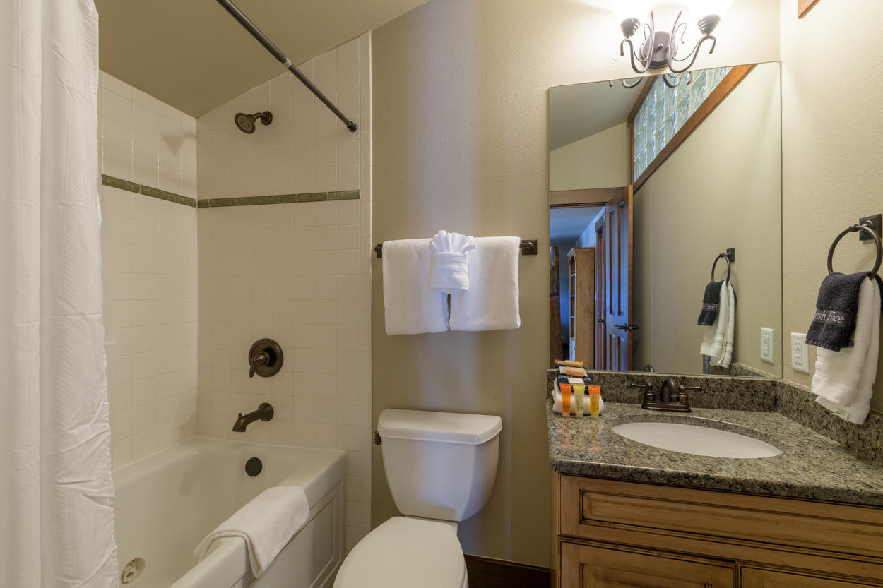 Guest Bedroom 5 has its own ensuite bathroom with a shower/tub combination and single sink.