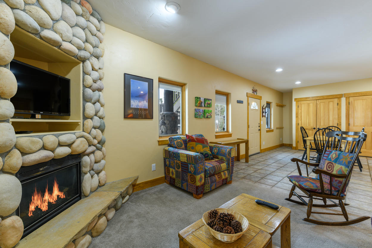 The lower level den has its own gas fireplace and flatscreen TV.