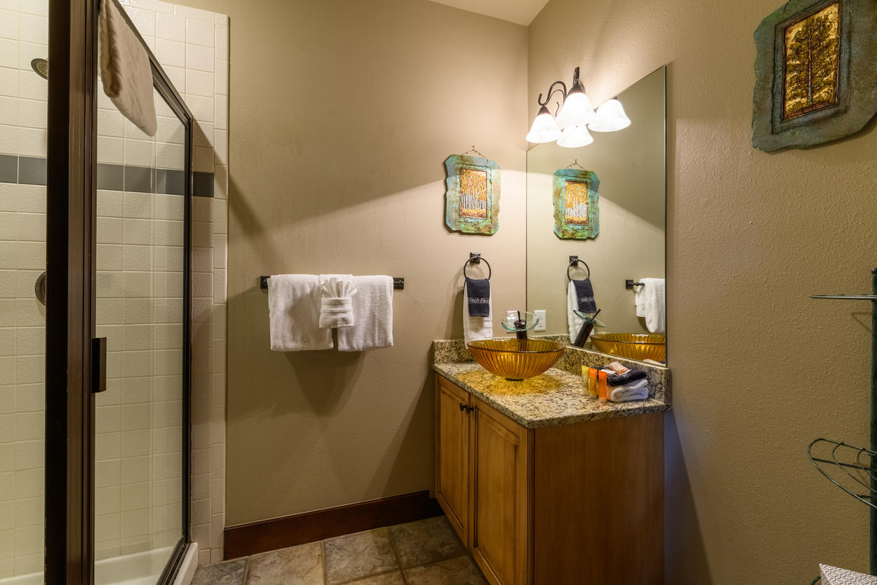 A shared bathroom on the main level has a walk-in shower and a single vanity.