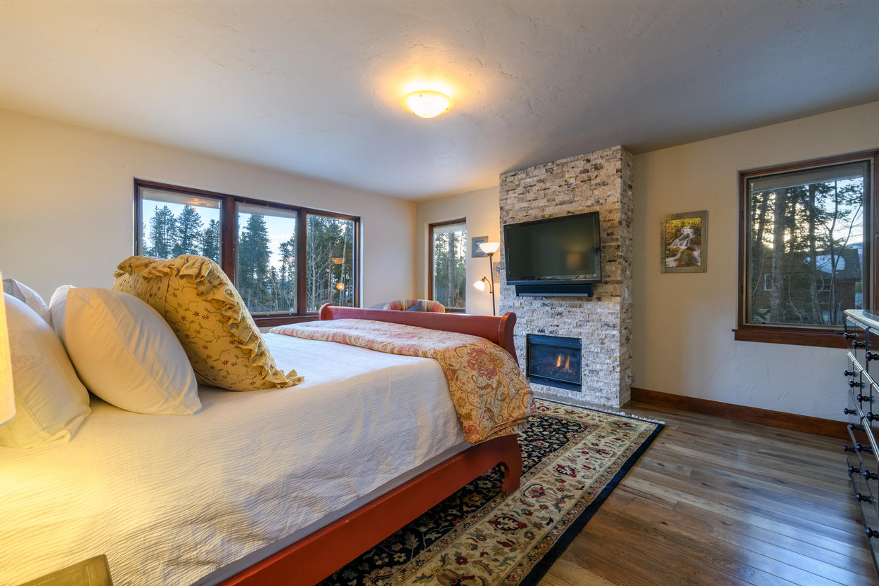 A gas fireplace sits below the TV in the Master Suite.