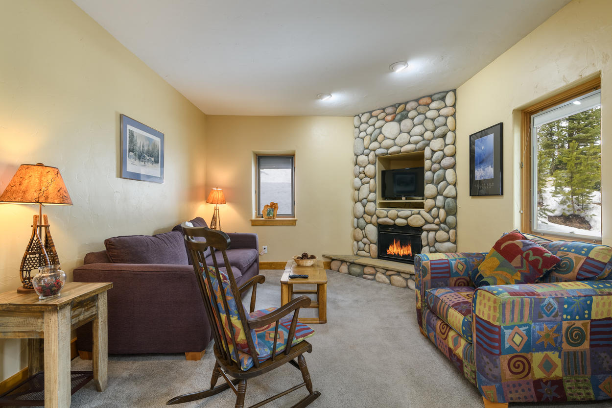 Features a pull out love seat, TV and gas fireplace.