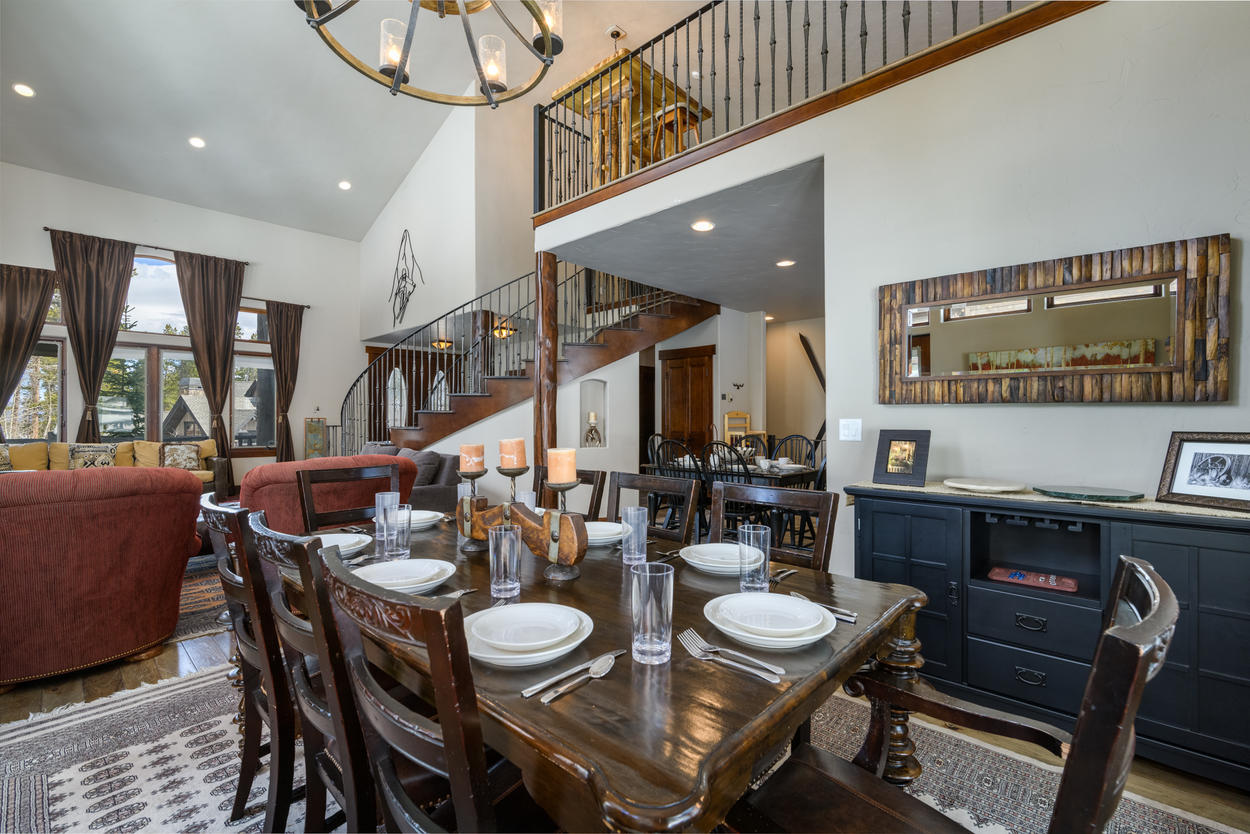 The formal dining table, located just off from the living area, can seat up to eight guests.