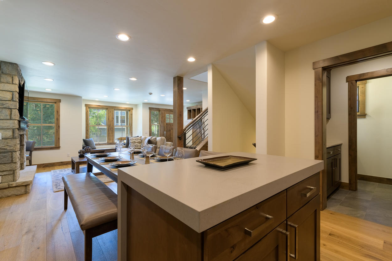 The island allows extra space for cooking, and is right next to the dining table.