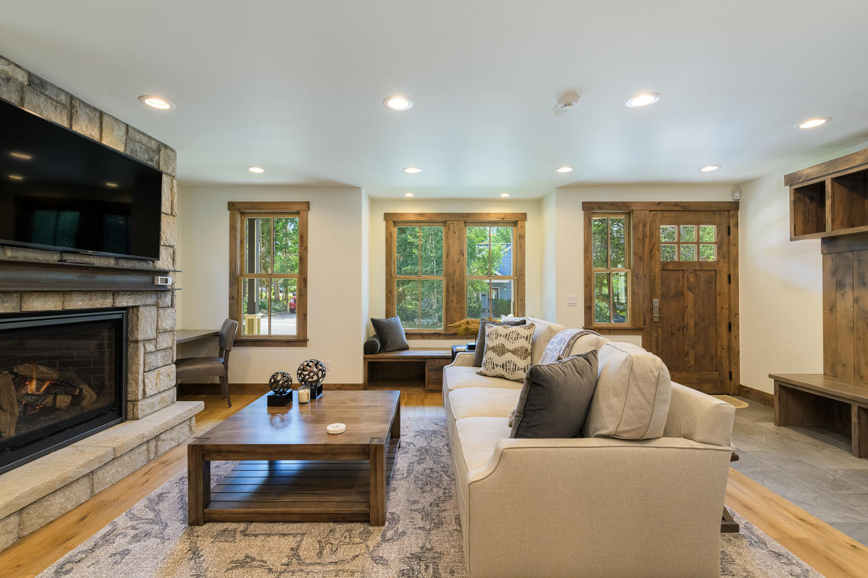 The living room features a gas fireplace and a cozy window nook.