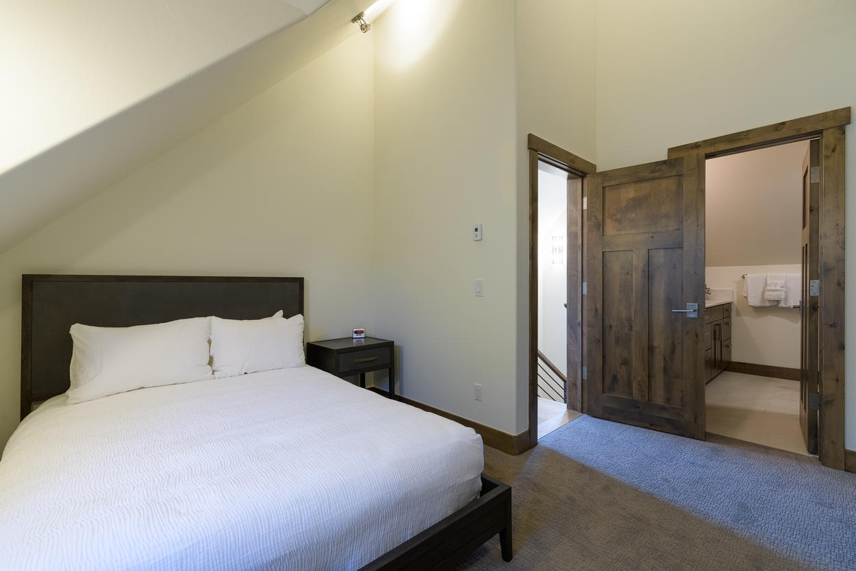 Guest Bedroom 2 is located upstairs and has a queen-size bed.