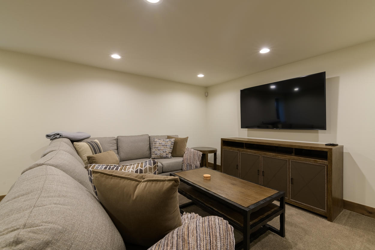 The den has a large TV, pull out sofa, and card table.