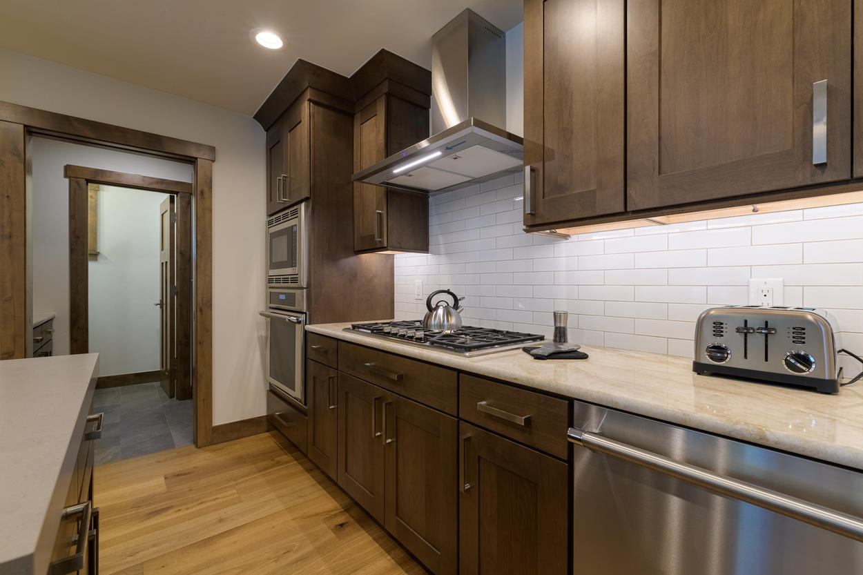 The kitchen is outfitted with brand new appliances for a wonderful cooking experience.