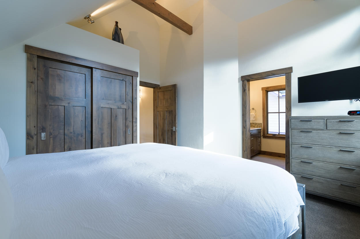 The master bedroom also has a large closet and an ensuite bathroom.