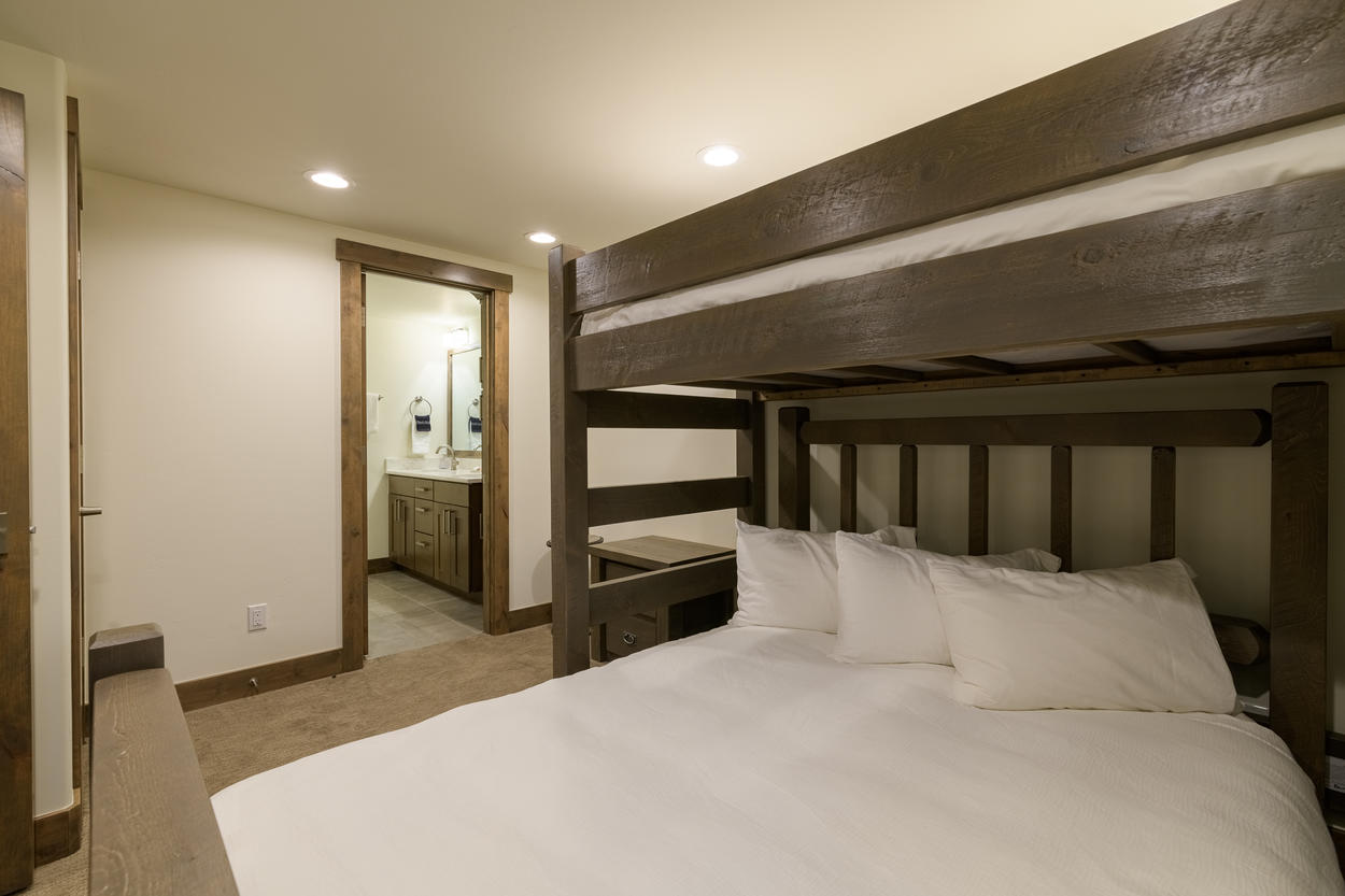 The third guest bedroom on the first floor has a captain's bunk with a queen-size bed on the bottom and a twin on top.