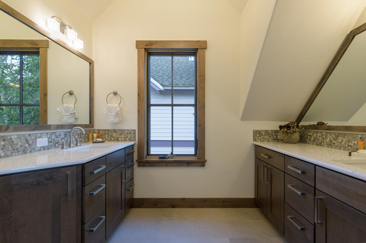 The master ensuite features two stand alone sinks.
