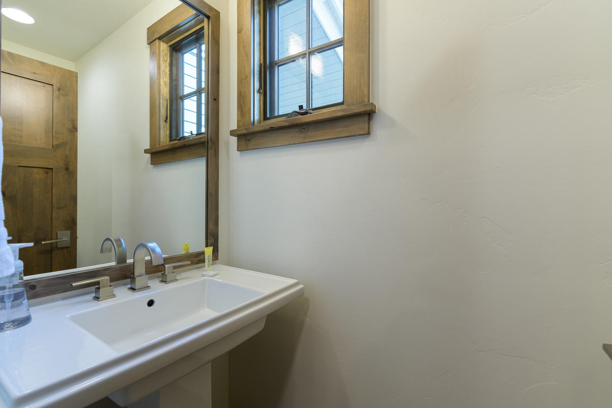 The half bath is located on the main level of the home.