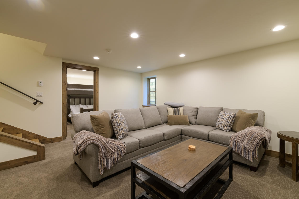 The first floor features a den with a pull out sofa bed.