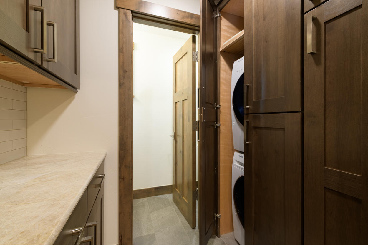 There is a laundry closet adjacent to the hallway bathroom.