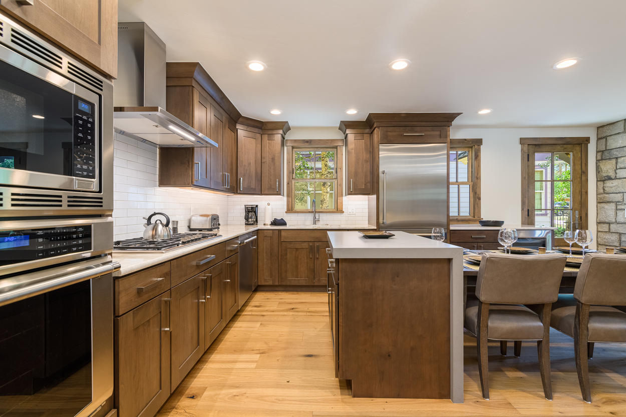 The kitchen has all stainless steel appliances and additional counter space at the island for prepping.