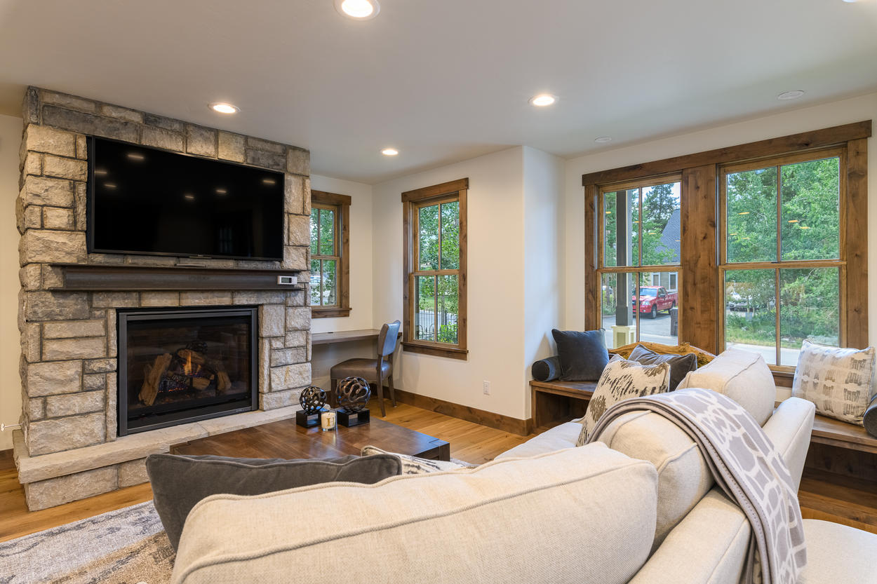 Enjoy a movie on the big screen TV in the living room.
