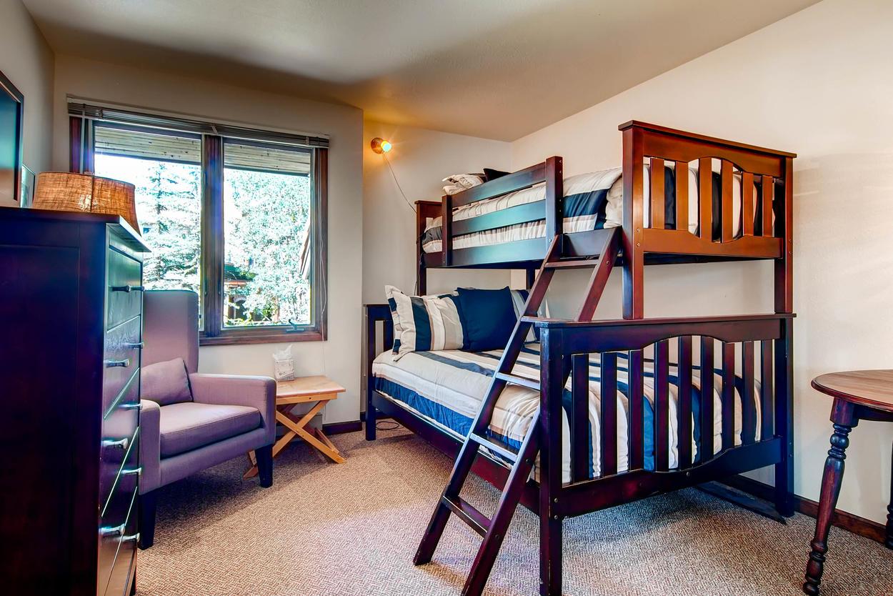 Guest Bedroom #3 sleeps 3 on its unique captain's bunk.