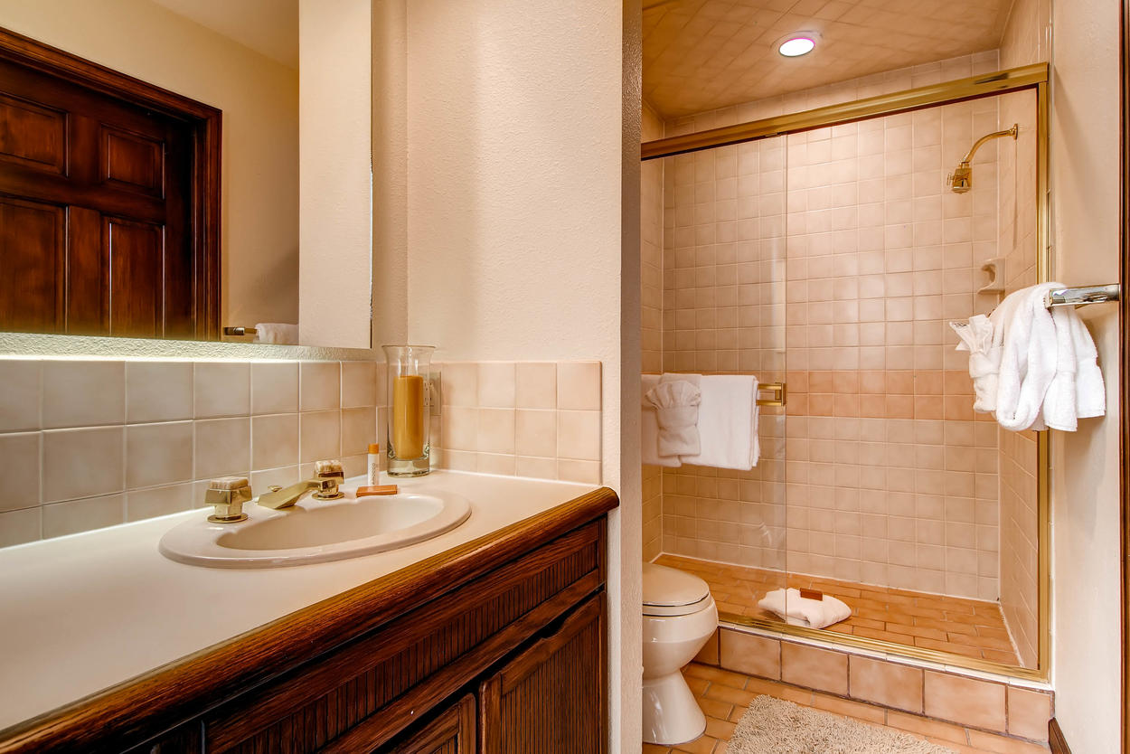 The private bathroom for Loft Bedroom #4 has a walk-in shower with elegant sliding glass doors.
