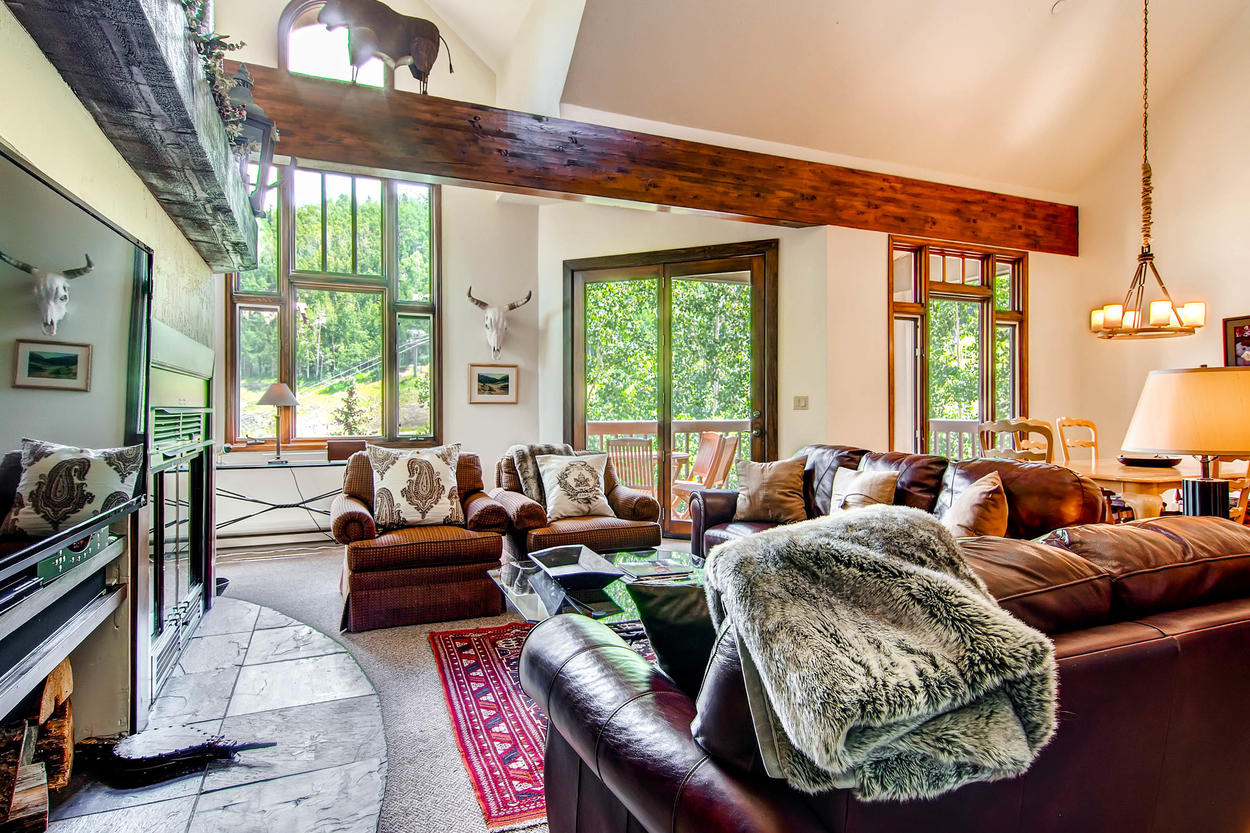 High vaulted ceilings, lots of windows, and an open layout give the space a very breathable atmosphere.