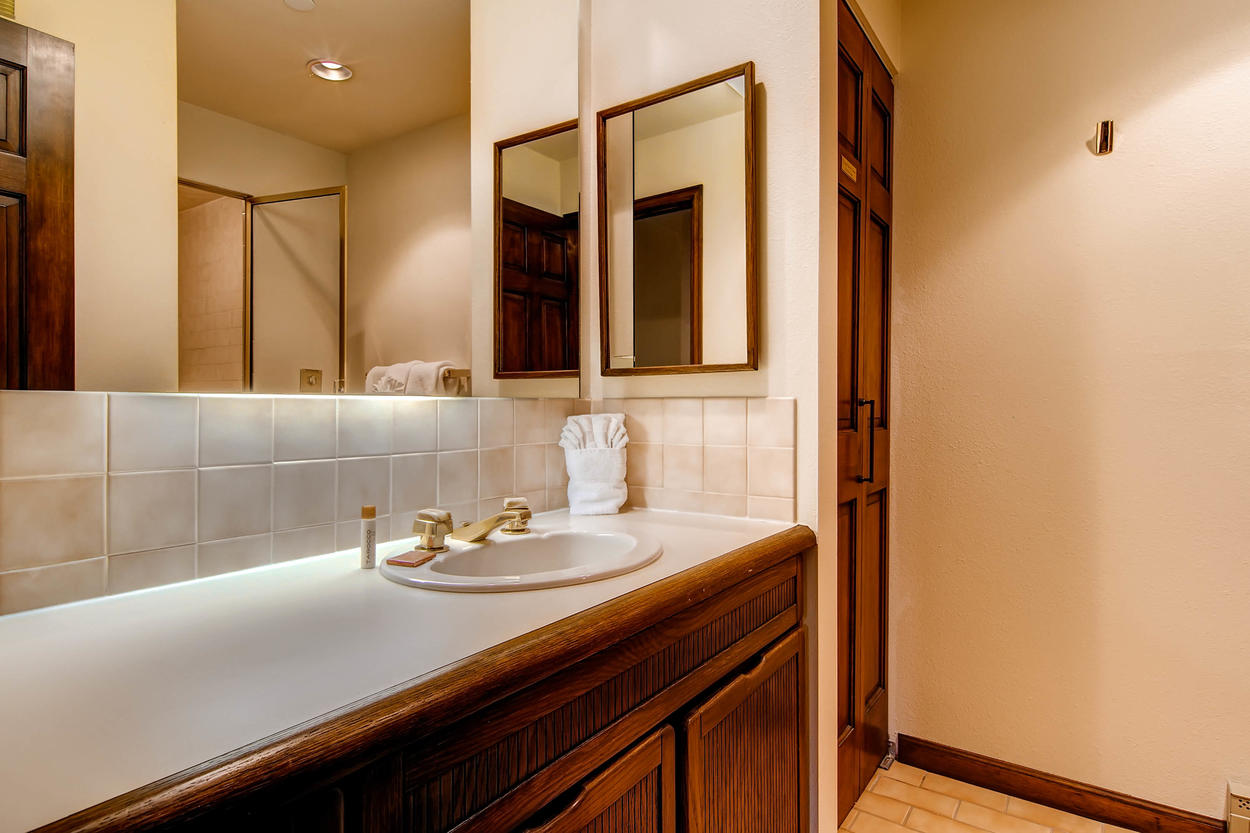This bathroom is across from Bedroom #2 has a large walk-in steam shower.